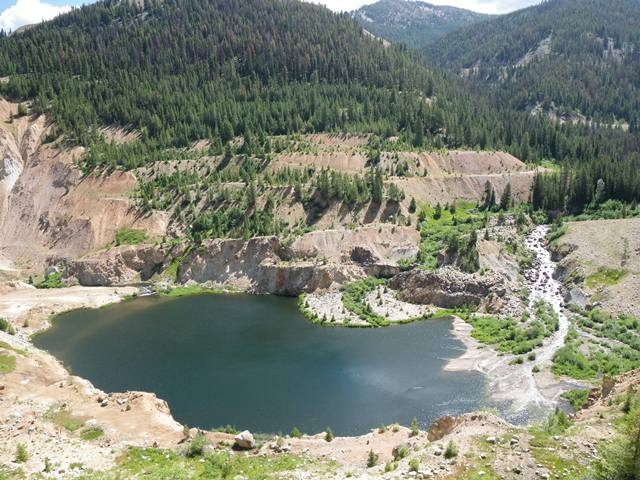 This artificial pond is a remnant of former mining operations in the Stibnite site.  Photo courtesy of the Idaho Conservation League