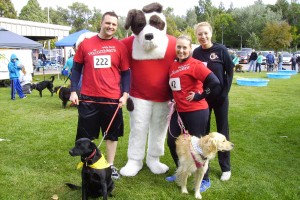 Wells Fargo employees Jeff Pickett, store manager; Brian Fletcher, personal banker, as Jack the Dog; Bonnie Brown, lead teller; and Courtney Mesia, personal banker participated with dogs Daisy and Bailey in the Pocatello Animal Shelter's Run with the Big Dogs. Photo courtesy of Wells Fargo.