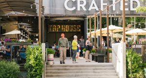 Patrons dine at Crafted in downtown Coeur d'Alene, Idaho Monday, June 19, 2017.