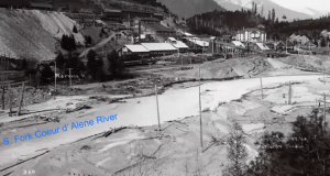 The Morning Mine in Mullan, Idaho, in 1903, showing the effect of dumping tailings in the South Fork of the Coeur d'Alene River.